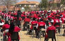 Glenvista High School pupils write exams outside after the school hall was torched. Picture: @Lesufi/Twitter