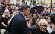 Spanish acting Prime Minister Pedro Sanchez (C) meets residents on 14 September 2019 in Orihuela. Spanish Prime Minister Pedro Sanchez visited flood-stricken regions of Spain, where rising waters claimed five lives and forced 3,500 people from their homes. Picture: AFP