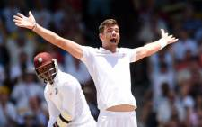 England's bowler James Anderson (R) successfully appeals for a LBW against West Indies batsman Marlon Samuels during day two of the final match of a three-match Test series between England and West Indies at the Kensington Oval Stadium in Bridgetown on 2 May, 2015. Picture: AFP.