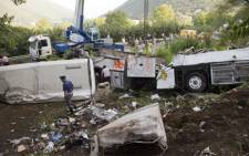 Police inspect remains of a bus crash on 29 July, 2013 in southern Italy. At least 39 people were killed and several more injured after a coach carrying pilgrims plunged off a motorway flyover. Picture:AFP