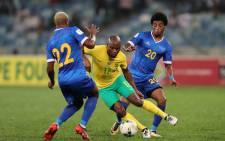 South Africa's Tokelo Rantie (in yellow) is blocked by Cape Verde players Tiago Almeida and Ryan Mendes during their 2018 World Cup Qualifying match at the Moses Mabhida Stadium in Durban on 5 September 2017. Picture: AFP