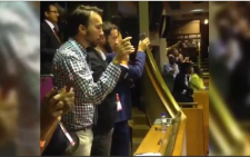 FILE: Screengrab from the 'bring back the signal' chant by the media in Parliament during State of the Nation Address 2015.