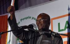 Roch Marc Christian Kabore waves to supporters at party headquarter in Ouagadougou on 1 December, 2015 after winning Burkina Fasos presidential election, official results showed, after a year of turmoil that saw the west African countrys former leader deposed and the military try to seize power in a coup. Picture: AFP.