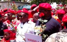 Economic Freedom Fighters supporters, led by Julius Malema (in white shirt) and Floyd Shivambu (to his left), pay a visit to Nelson Mandela's home in Houghton, 12 December 2013. Picture: Chanel September/EWN.