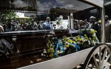 Thoriso Themane's casket placed in a horse-drawn glass hearse before moving to the cemetery. Picture: Kayleen Morgan/EWN