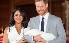 FILE: Britain's Prince Harry, Duke of Sussex (R), and his wife Meghan, Duchess of Sussex, pose for a photo with their newborn baby son in St George's Hall at Windsor Castle in Windsor, west of London on May 8, 2019.  Picture: AFP.
