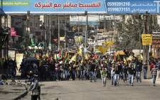 Palestinians protesters marching toward the Kalandia checkpoint leading from the West Bank to Jerusalem, 07 November 2014. Israel deployed thousand of police forces in Jerusalem and limited Palestinian access to the al-Aqsa mosque compound, during the Muslim Friday prayers. Picture:EPA/ATEF SAFADI.