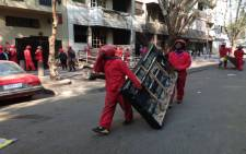 FILE: About 500 Red Ants conducted an eviction of Wellington House in Hillbrow, a flat notorious for being drug den and a criminal hotspot. Picture: EWN.