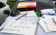 Uber drivers dressed in reflector jackets gathered in Marlboro where they made posters with anti-violence slogans on 11 February 2017. Picture: Queenin Masuabi/EWN.