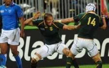 Juan de Jongh celebrates his try with Gio Aplon during the 2011 Rugby World Cup pool D match against Namibia in Auckland on 22 September 2011. Picture: AFP