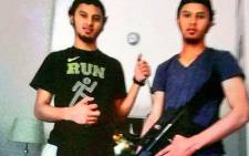 Police have released photographs recovered from the twins' cellphones. One of the pictures which show the brothers posing with what police say appears to be an assault rifle. Picture: Supplied.