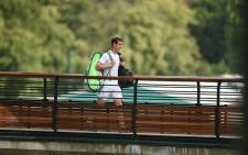 A dejected Andy Murray trudges away from court after being eliminated from Wimbledon. Picture: Facebook.