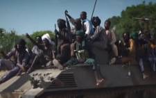 FILE: A screengrab taken on November 9, 2014, from a new Boko Haram video released by the Nigerian Islamist extremist group Boko Haram and obtained by AFP shows Boko Haram fighters parading on a tank in an unidentified town. Picture: AFP.