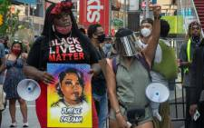Protesters gather at Times Square to march uptown via the Henry Hudson Parkway on August 9, 2020 in New York City. Protesters took to the streets to demand the arrest of the officer responsible for the death of Breonna Taylor on March 13, 2020 in Louisville, Kentucky.