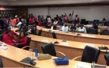 A video screengrab of a group of frustrated employees who stormed a West Rand District Municipality council meeting and held councillors hostage demanding salaries be paid. Picture: Twitter