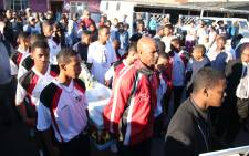 The Riverside Rangers under-18 soccer team carry their teammate Fernando Williams' coffin during his funeral. Picture: Bertram Malgas/EWN