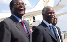 Zimbabwean president Robert Mugabe (left) welcomes former South African president Thabo Mbeki at Harare International Airport. Picture: Taurai Maduna/Eyewitness News