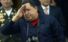 Venezuelan president Hugo Chavez salutes during the visit of Belarusian Deputy Prime Minister Vladimir Semashko at Miraflores presidential palace in Caracas on 2 June 2012. Picture: AFP