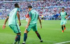FILE: Portugal's captain Cristiano Ronaldo and Luis Nani celebrate after the team played to a 3-3 draw but still managed to progress to the Euro 2016 last 16 on 22 June 2016. Picture: Facebook.