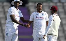 West Indies' Shannon Gabriel (C) celebrates with West Indies' Jason Holder (L) after bowling England's Dom Bess (not pictured) on the fourth day of the first Test cricket match between England and the West Indies at the Ageas Bowl in Southampton, southwest England on 11 July 2020. Picture: AFP