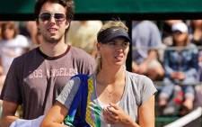 Maria Sharapova and her fiance, basketball star Sasha Vujacic. Picture: AFP.