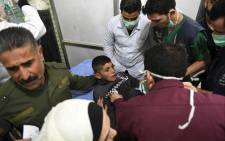FILE: A Syrian boy receives treatment at a hospital in the regime-controlled Aleppo on 24 November 2018. Official Syrian media accused the armed opposition of launching an attack with 'toxic gas' on the northern city, but a leading rebel alliance has denied any involvement. Picture: AFP