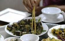 This photo taken on 24 August 2018 shows a customer consuming a snake sausage dish served at a speciality restaurant in Yen Bai province in Vietnam. Picture: AFP