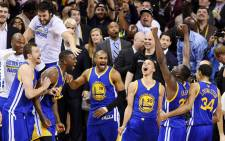 The Golden State Warriors celebrate their 105 to 97 win over the Cleveland Cavaliers in Game Six of the 2015 NBA Finals at Quicken Loans Arena on 16 June, 2015 in Cleveland, Ohio. NOTE TO USER: User expressly acknowledges and agrees that, by downloading and or using this photograph, user is consenting to the terms and conditions of Getty Images License Agreement. Picture: AFP.