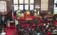 Parishioners of Emanuel AME Church hold their first service since Wednesday's mass shooting.Picture: CNN/screen grab