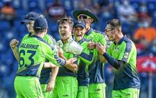 Ireland seam bowler Curtis Campher celebrates with his teammates after taking four wickets in four balls in a Twenty20 International against the Netherlands on 18 October 2021. Picture: @ICC/Twitter.