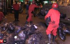 Red Ants clean up the streets of Johannesburg following strike by Pikitup employees. Picture: Kgothatso Mogale/EWN