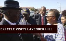 Police Minister Bheki Cele listens to Lavender Hill residents during a walk about. Picture: Bertram Malgas