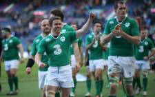 Irelands Eoin Reddan (L) and Ireland's players celebrate at the final whistle in the Six Nations international rugby union match between Scotland and Ireland at Murrayfield in Edinburgh, Scotland on 21 March 2015. Ireland won the game 40-10. Picture: AFP