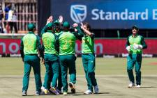FILE: South Africa fielder David Miller (2L) is congratulated after the dismissal of Australia batsman Mitchell Marsh during the 3rd ODI between South Africa and Australia at Senwes Park on 7 March 2020. Picture: AFP
