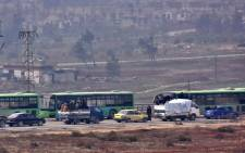 Buses are seen during an evacuation operation of Syrian rebel fighters and civilians from a opposition-held area of Aleppo towards rebel-held territory in the west of Aleppo's province on 16 December, 2016. Picture: AFP.