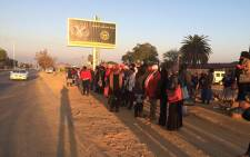Hundreds of commuters have been waiting in vain in the freezing cold for taxis on the sides of roads following a taxi strike in Mamelodi on 9 July 2015. Picture: Barry Bateman/EWN.