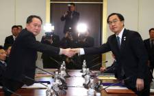 FILE: South Korea's Unification Minister Cho Myung-Gyun (R) shakes hands with North Korean chief delegate Ri Son-Gwon. Picture: AFP.