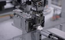 A screengrab of Daisy stripping out components from an old iPhone. Picture: YouTube