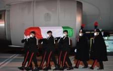 This photo taken and handout on 23 February 2021 by the Italian Foreign Ministry shows Carabinieri police officers carrying one of the flag-draped coffins of slain Italian Ambassador Luca Attanasio and Italian Carabinieri police officer Vittorio Iacovacci, upon the arrival at Rome's Ciampino airport of an Italian Air Force plane flying from Goma in the DRC. Picture: AFP