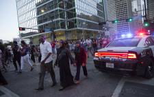 People rally in Dallas, Texas, on Thursday, 7 July, 2016 to protest the deaths of Alton Sterling and Philando Castile. Picture: AFP.