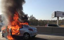 Car on fire just before William Nicol on N1 North on 4 September 2013. Picture: Joanna Oosthuizen/iWitness (via twitter)