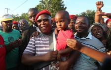 EFF Leader Julius Malema and Police Minister Nathi Mthetwa visited the families of the two men killed during a service delievery protest in Mothutlong on Tuesday. Picture: Sebabatso Mosamo/EWN