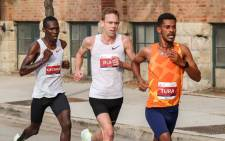 Seifu Tura (right) pulled away late to take the victory in 2hrs 6mins 12secs with American Galen Rupp (centre) second, 23 seconds adrift, and Kenya's Eric Kiptanui (left) third in 2:06:51.Picture: @ChiMarathon/Twitter