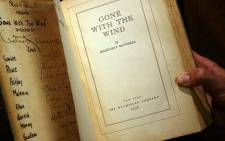 "In this file photo a copy of the book ""Gone With the Wind"" by Margaret Mitchell, signed by producer, director, and most of speaking cast of the 1939 Hollywood film, is pictured 18 October 2007 in Los Angeles. Picture: AFP"