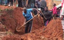 A video grab taken from AFP TV footage shows locals carrying out excavation work following landslides which led to the death of at least 42 people in the western Cameroon city of Bafoussam on 29 October 2019. Picture: AFP