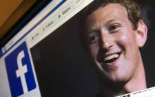 A picture taken on 22 March 2018 shows an illustration picture featuring Facebook founder and CEO Mark Zuckerberg who issued a public apology for the hijacking of personal data from millions of people. Picture: AFP.