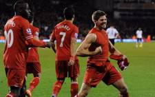 Liverpool's captain, Steven Gerrard celebrates with his team mates after their win against Fulham in the English Premier League on 12 February 2014. Picture: Facebook.