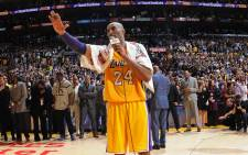 Kobe Bryant #24 of the Los Angeles Lakers speaks to the crowd after the game against the Utah Jazz on 13 April, 2016 at Staples Center in Los Angeles, California. Picture: AFP.
