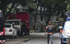 Bangladeshi army soldiers patrol a street during a rescue operation as gunmen take position in a restaurant in the Dhaka's high-security diplomatic district on 2 July, 2016 where several people including foreigners are believed to be trapped. Picture: AFP.