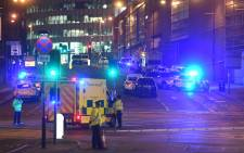 Emergency response vehicles at the scene of a terrorist attack during a concert by US star Ariana Grande in Manchester on 23 May 2017. Picture: AFP.